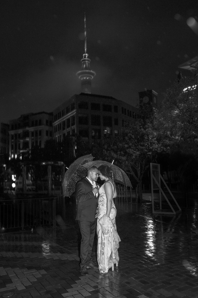 Monochrome photo of the bride and groom in the night at the Auckland Viaduct