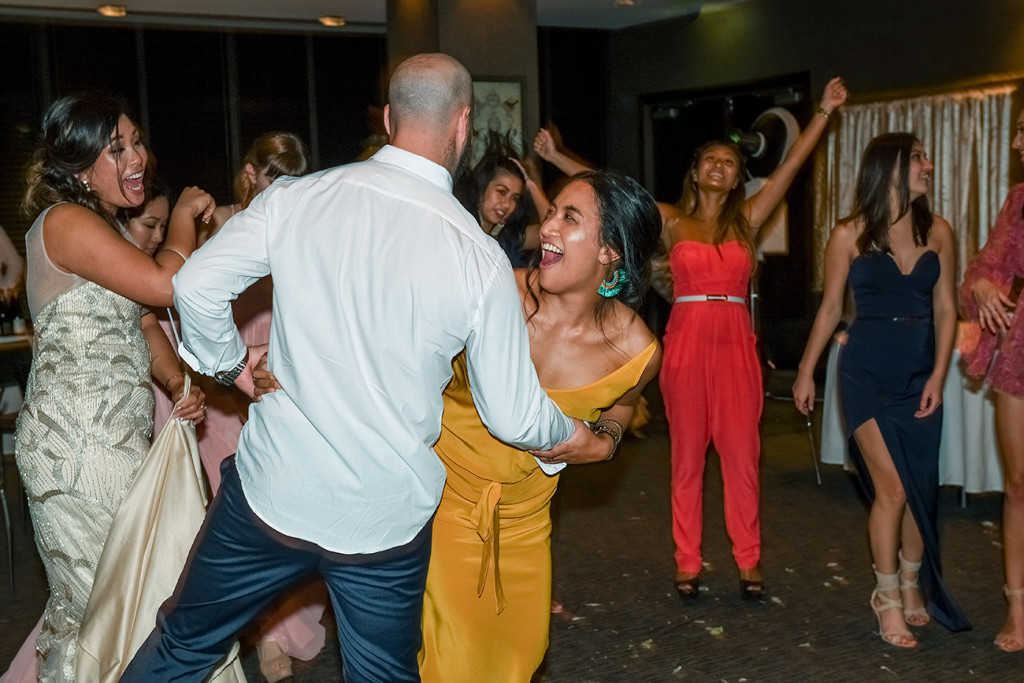 Wedding guests laugh and dance at the Wedding ceremony in Sofitel Auckland