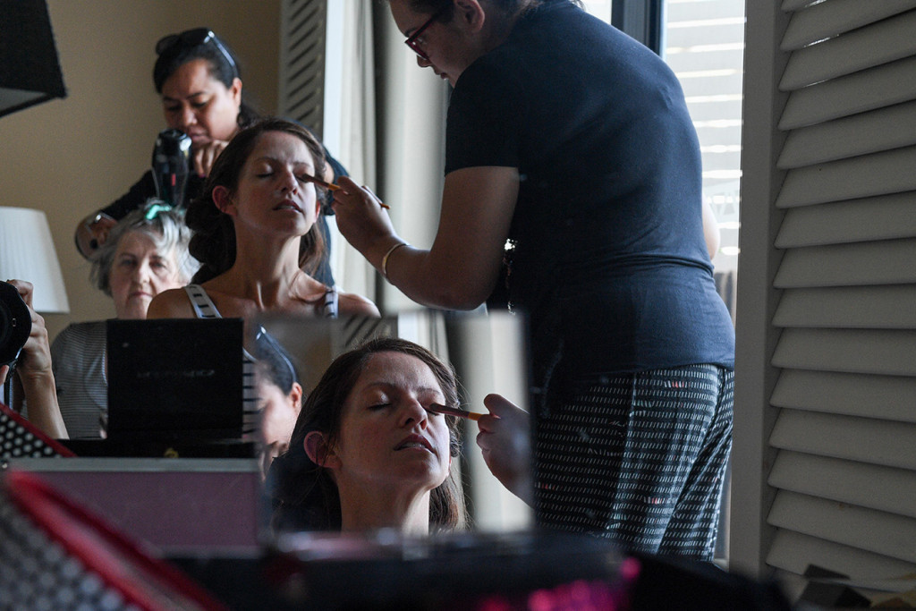 Inception reflection photo of bride getting her makeup done