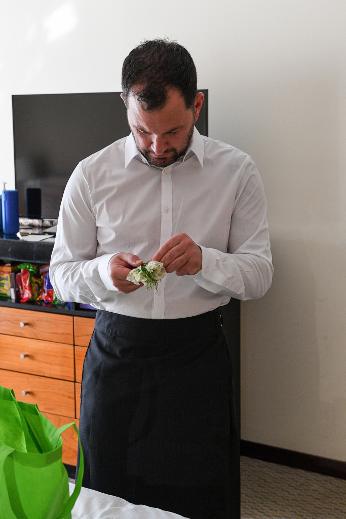 The groom checking his boutonniere at the Sofitel Fiji