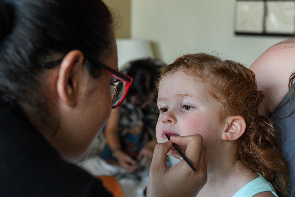 Cute little Flower girl gets her lipstick done at Sofitel Fiji wedding