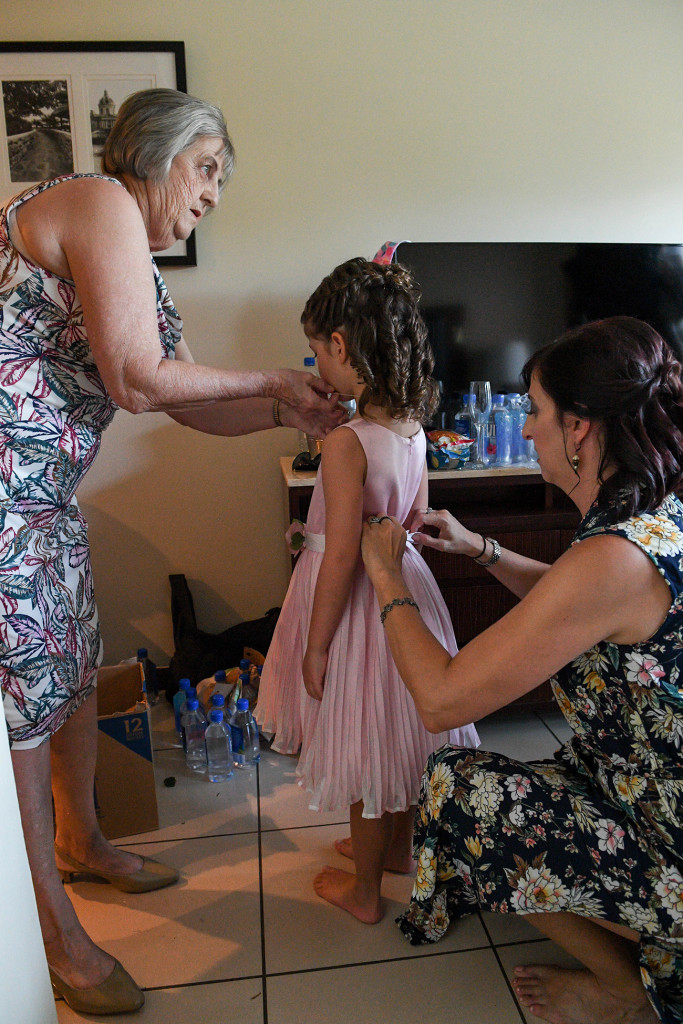 Flowergirls being dressed up during wedding preparation in Sofitel Fiji
