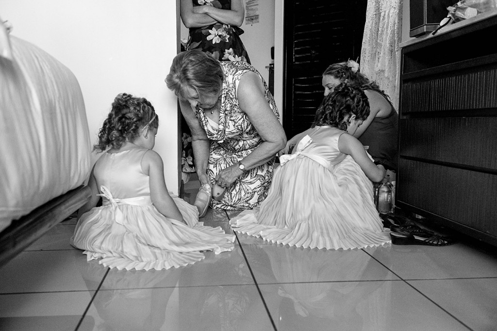 Black and white photo of flowergirls getting ready in wedding preparations