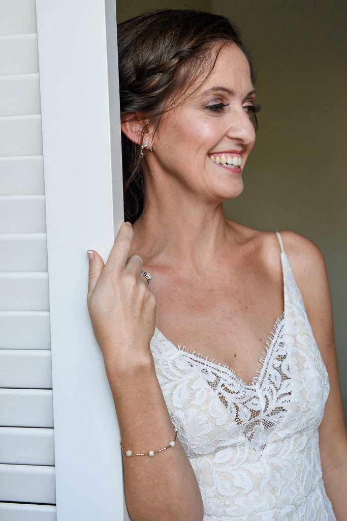 Stunning bride smiles at the door in Sofitel Wedding Fiji