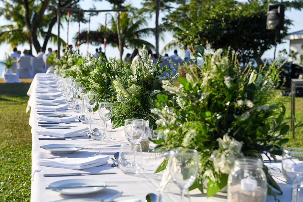 White and green table layout in outdoor Fiji wedding at Sofitel