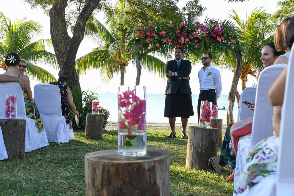 Groom and groomsmen wait at the altar of the outdoor beach wedding in Sofitel Fiji