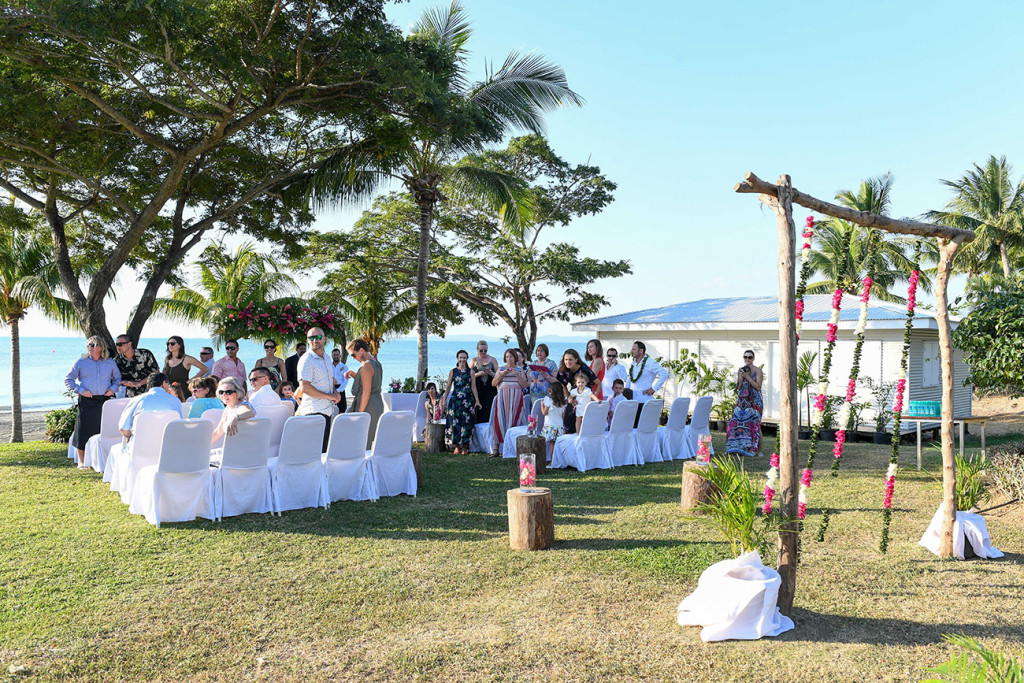 Wedding guests at the Sofitel Fiji beach wedding ceremony