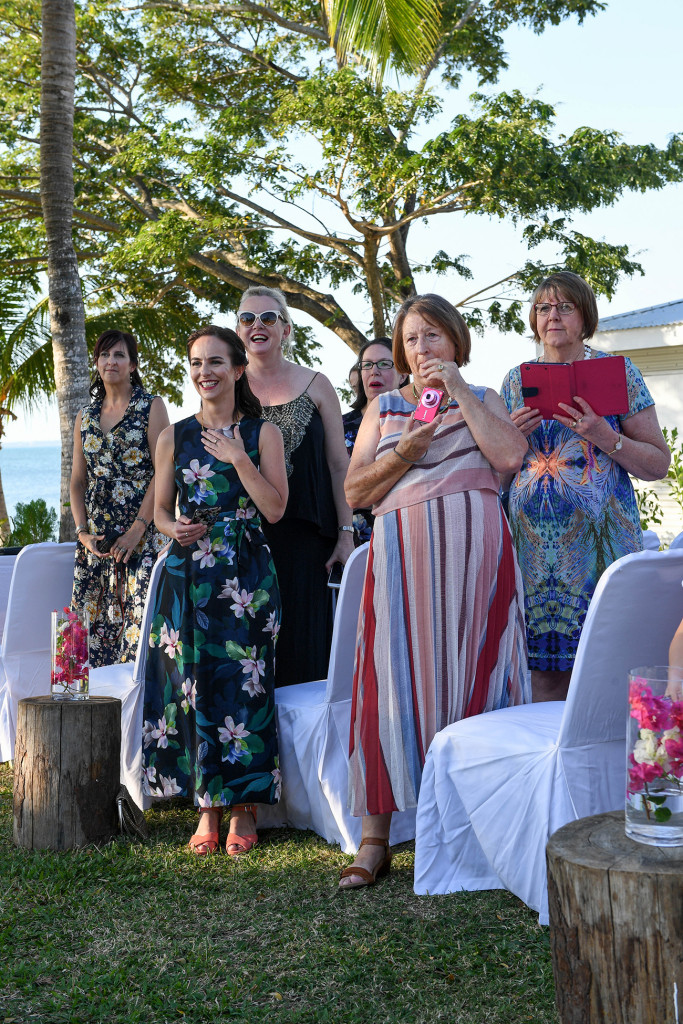 Wedding guests rise to welcome the couple to the cermony on Sofitel Fiji