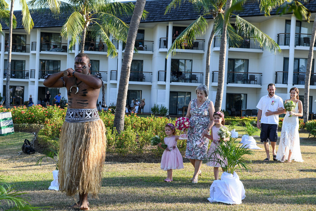 Fiji warrior dances ahead of the bridal party in Fiji Sofitel wedding