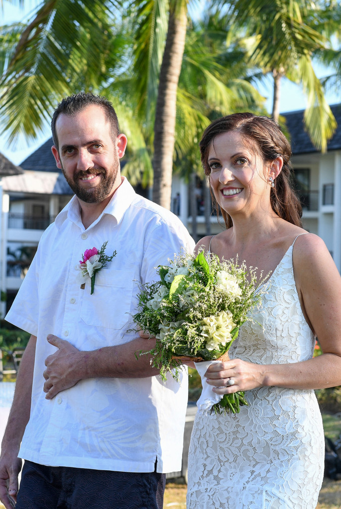 Bride walks down the aisle in outdoor Fiji Sofitel wedding