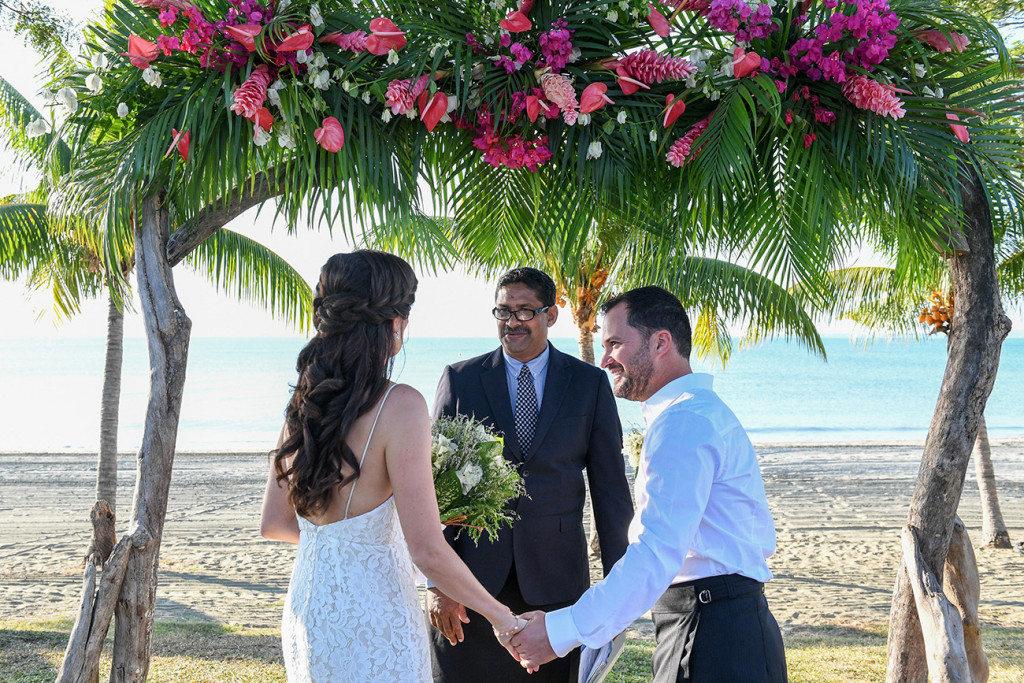 Bride and groom at altar of beach Fiji wedding ceremony at Sofitel Fiji