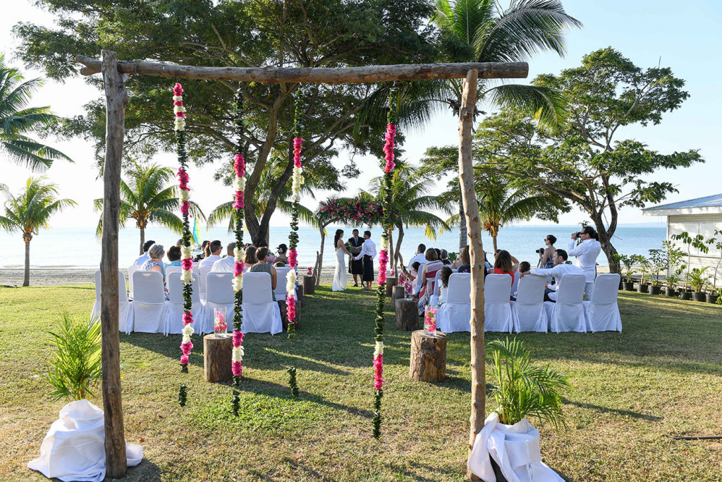 Wideshot of guests and wedding ceremony in Sofitel Fiji wedding