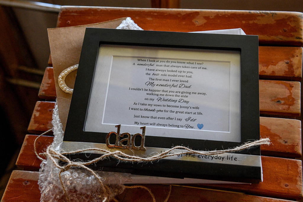 Glass frame of wedding guest list