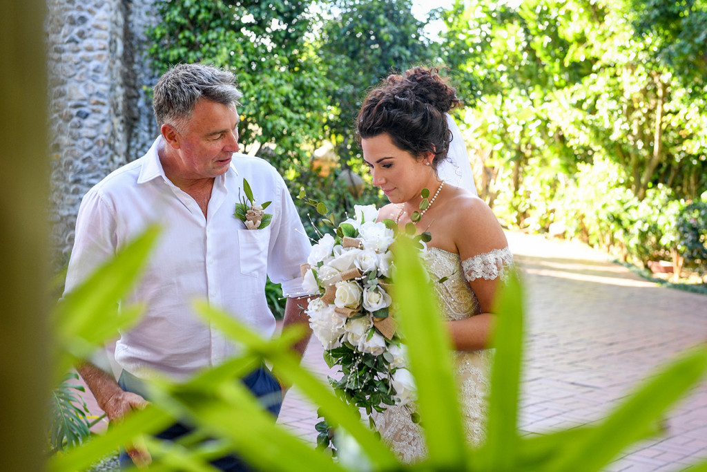 Stunning bride and father walking down the aisle