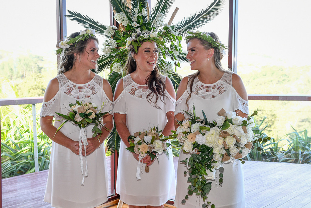 Bohemian bridesmaids in boho white off shoulder dresses and white flower bouquet at the Outrigger Fiji