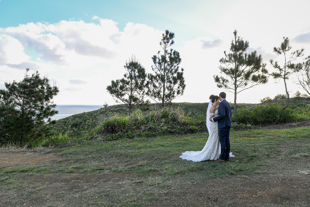 Wideshot of bride and groom kissing on Outrigger Fiji hills