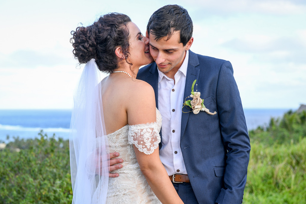 Bride whispers to her groom at the Outrigger Fiji