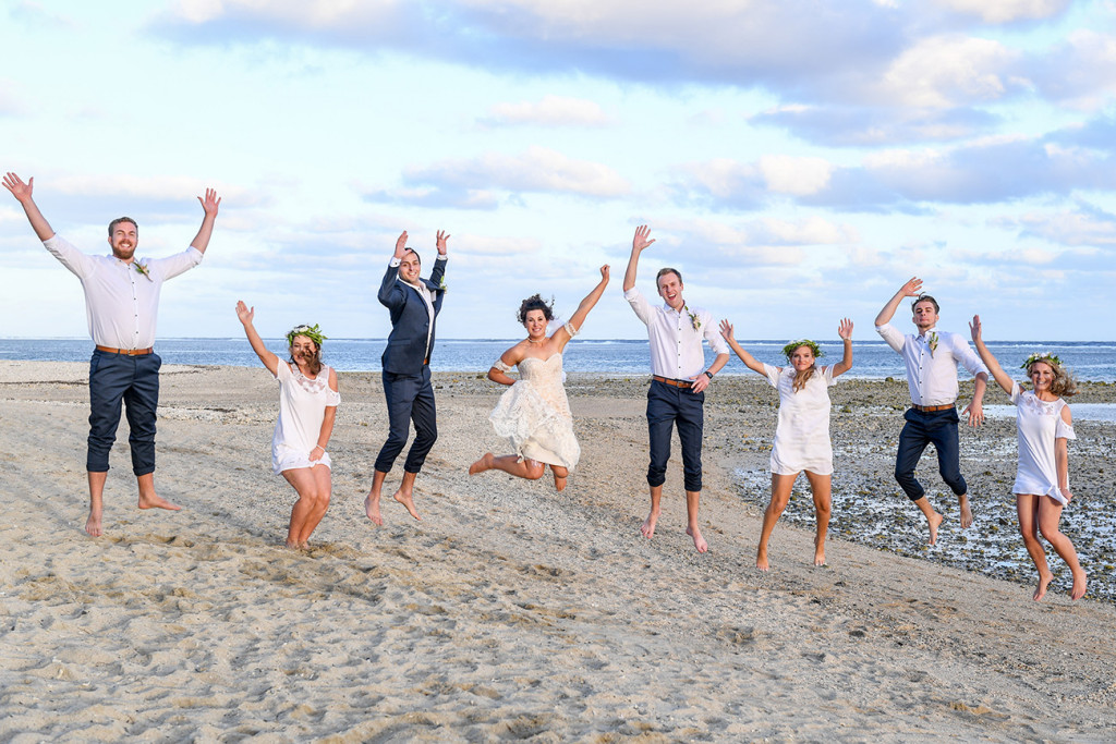 Bridal party jump into the air at the Outrigger Fiji