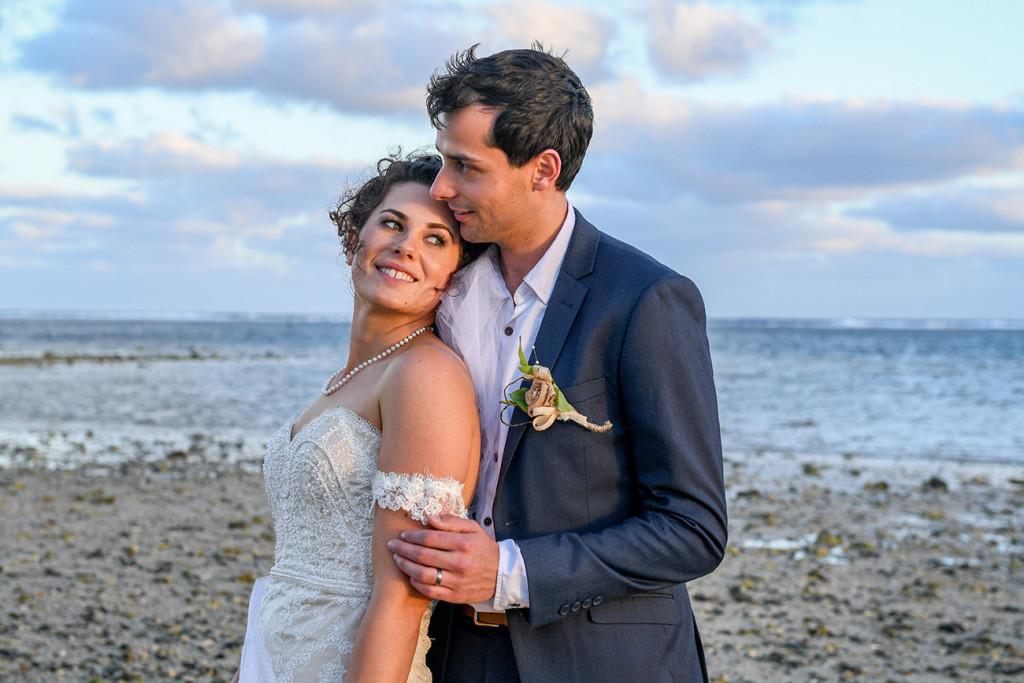Golden sunrays glow off the bride and groom at the Outrigger Fiji