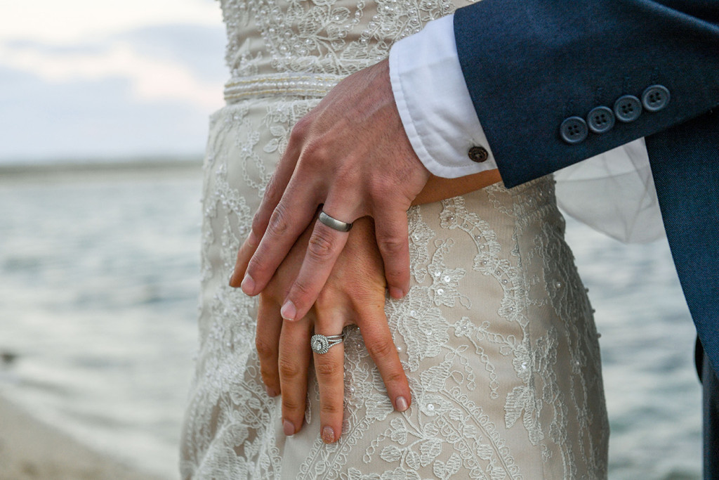 Closeup of gold rings on bride and groom at the boho wedding at the Outrigger Fiji