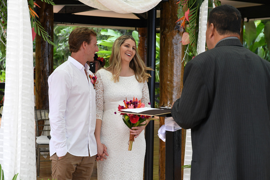Bride smiling at the celebrant for her elopement at the Warwick, Fiji