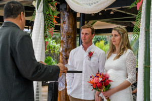 Bride and groom looking at the celebrant for their elopement in Fiji