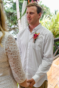 Groom looking at the celebrant for their elopement in Fiji