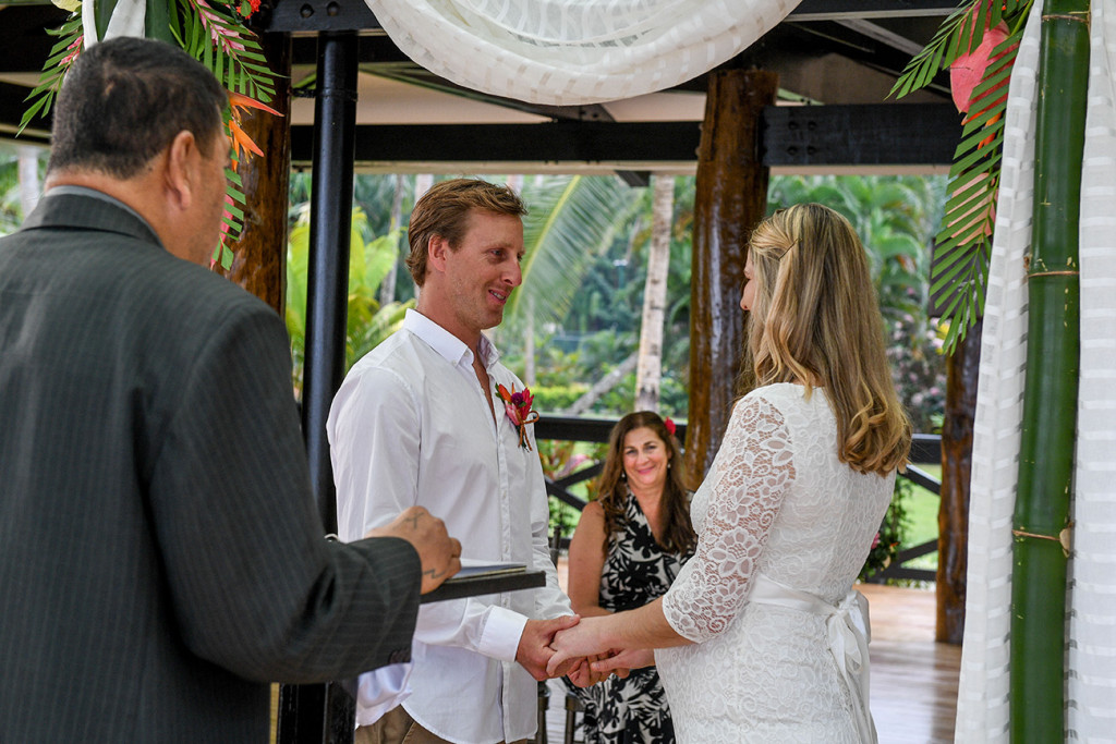 Mother is looking her daughter getting married at the wedding ceremony at the Warwick in Fiji