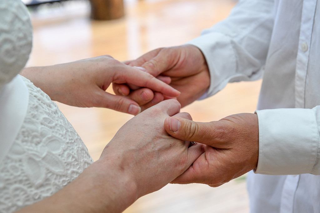 Bride and groom are holding hands at their elopement ceremony