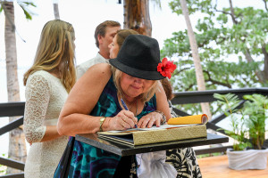 The mother is signing the register for her wedding in Fiji