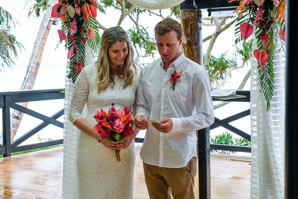 The groom has received the certificate of wedding after the ceremony in Fiji