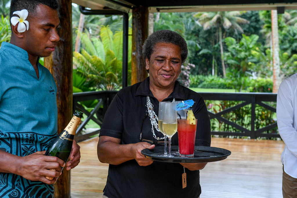 The wedding planner at the Warwick gives drinks to the guests