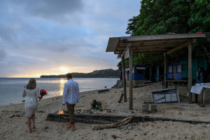The bride and groom at sunset on the Fiji beach