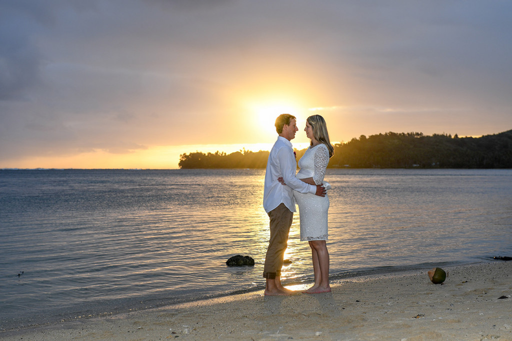 The bride and groom at sunset on the Fiji beach looking at eachothers