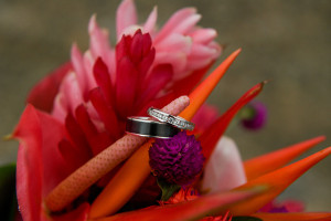 Close up on the wedding ring with the tropical flowers from the bouquet