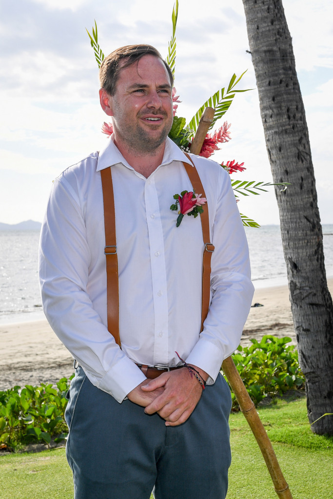 Anxious groom waiting beside the beach for his bride at the Denarau Fiji