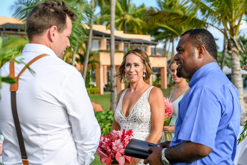 The groom receives the bride at the altar at the Sheraton Denarau Fiji