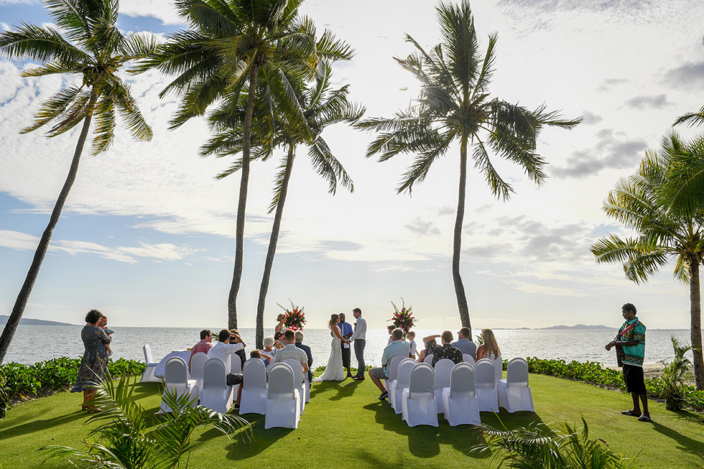 Wideshot of the wedding ceremony overlooking breathtaking Fiji beach at the Sheraton Denarau Fiji