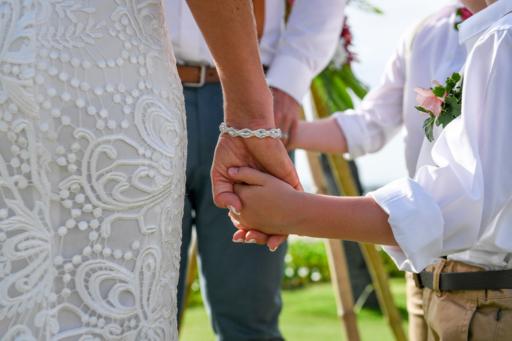 Closeup as Bride holds her son's hand