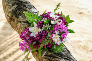 Wedding bouquet purple and white flowers , Matangi island resort in Fiji