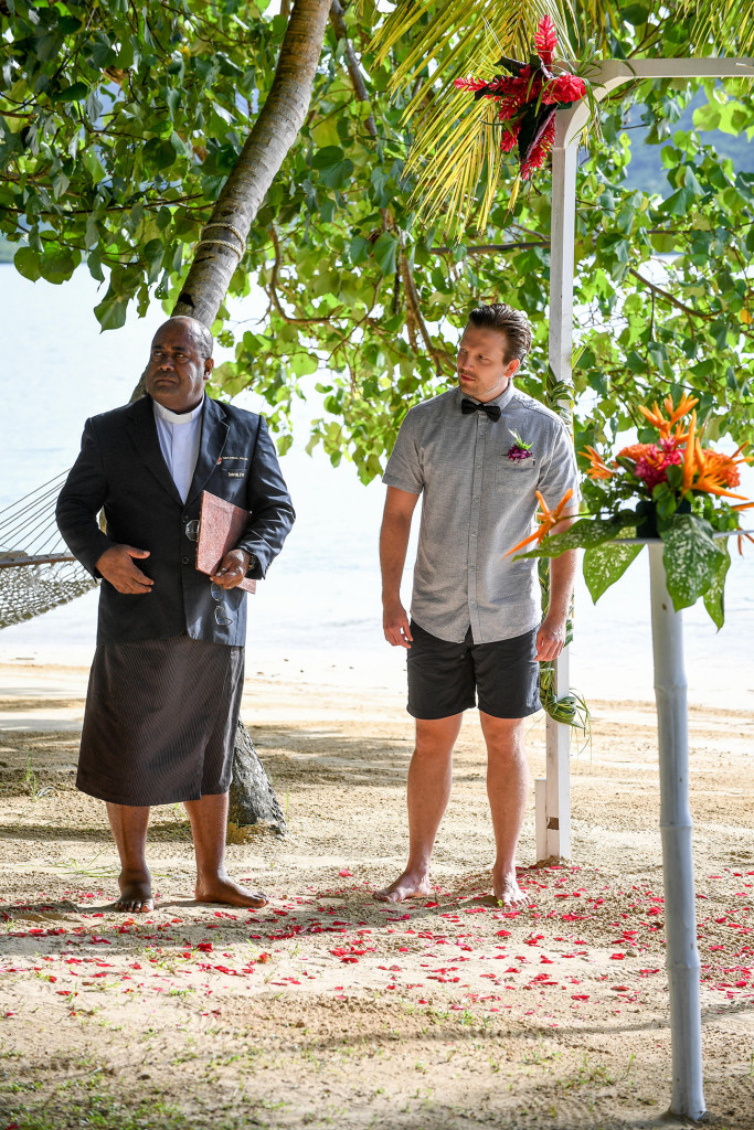 the groom is looking the bride entering the wedding ceremony, Matangi island resort in Fiji