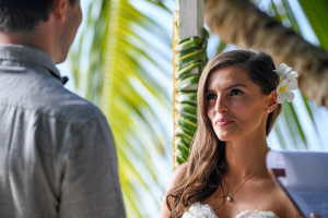 Portrait of the bride looking at the groom during the wedding ceremony, Matangi island resort, Fiji