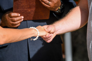 Close up on the bride and groom's hands holding bride and groom, Matangi island resort, Fiji
