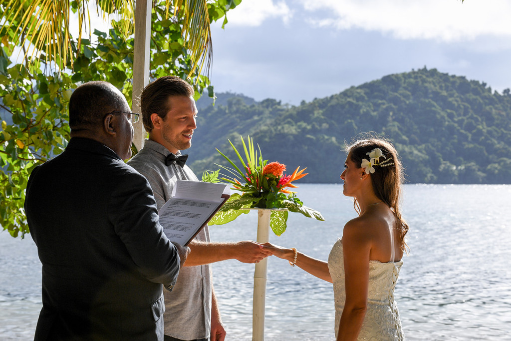 Groom is holding the bride's hand wedding ceremony, Matangi island in Fiji