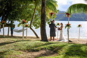 Wedding ceremony by the beach and palm trees at Matangi island resort, Fiji