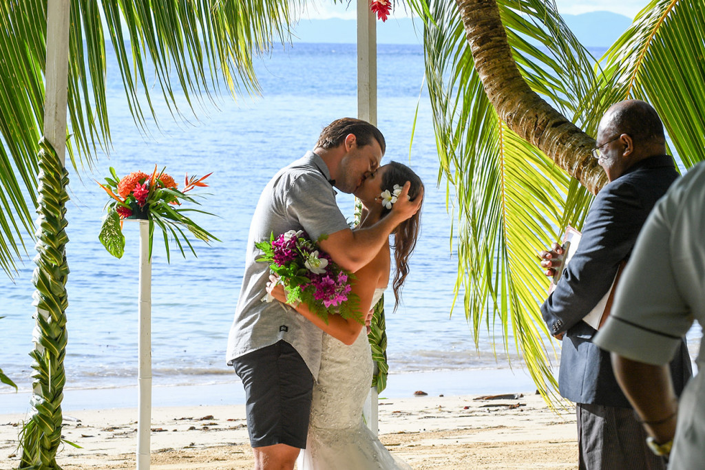 First kiss of the wedding couple at the end of the ceremony, Matangi Fiji
