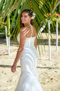 Bride's back with the shade of a palm tree on her back, Matangi island Fiji