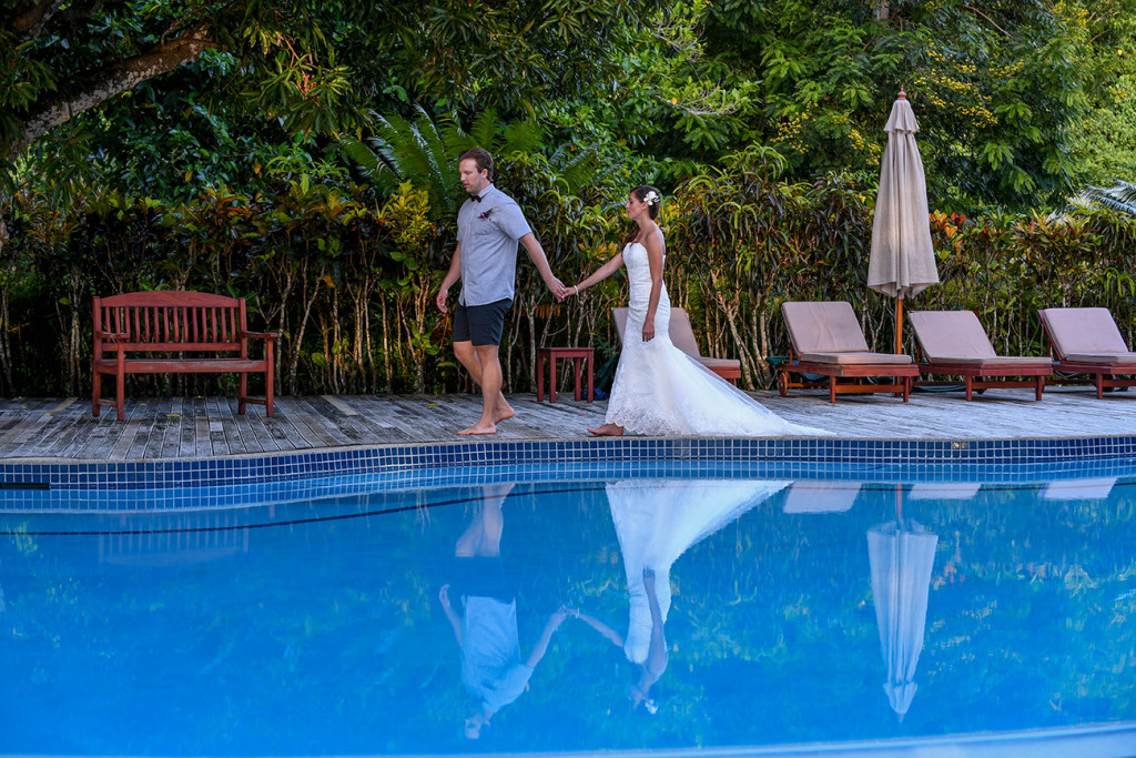 Bride and groom by the swimming-pool at Matangi island resort in Fiji