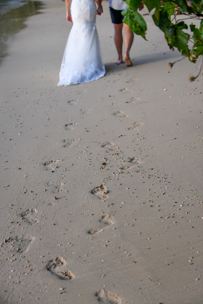 footprint on the white sand of the bride and groom at Matangi island resort in Fiji
