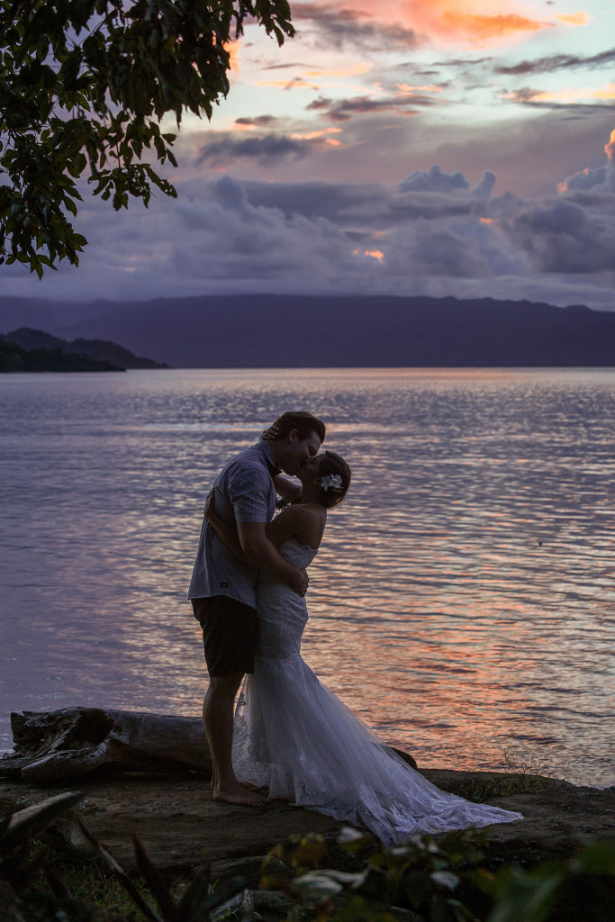 Married couple kissing at Sunset, Matangi Island resort, Fiji